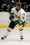 6 January 2007: University of Vermont forward Colin Vock (10) from Plymouth, MI, in action against the University of New Hampshire Wildcats at Gutterson Fieldhouse in Burlington, Vermont. The Wildcats defeated Vermont 2-1 to sweep the two-game weekend series in front of a record setting 49th consecutive sellout at the Gut...Mandatory Photo Credit: Ed Wolfstein Photo.<br />