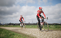 Tiesj Benoot (BEL/Lotto-Soudal) & Jasper De Buyst (BEL/Lotto-Soudal) over the cobbles of sector 12: Orchies (1.7km).<br /> Benoot crashed heavily just a few days earlier in De Ronde van Vlaanderen (where they feared for the end of his spring campaign at first), but stubbornly insisted he'd ride the Roubaix recon to see if he'd be fit enough for the upcoming sunday.<br /> His team manager Marc Sergeant was baffled by his hardness claiming he 'never saw anybody like him'<br /> <br /> recon of the 114th Paris - Roubaix