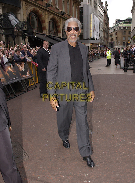 "MORGAN FREEMAN.At the European Premiere for ""Batman Begins"",.Odeon Cinema, Leicester Square, London, .June 12th 2005..full length grey suit sunglasses.Ref: FIN.www.capitalpictures.com.sales@capitalpictures.com.©Steve Finn/Capital Pictures."