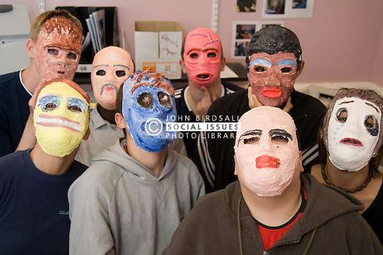 Group of students wearing masks they have made; Sycamore Centre Nottingham,