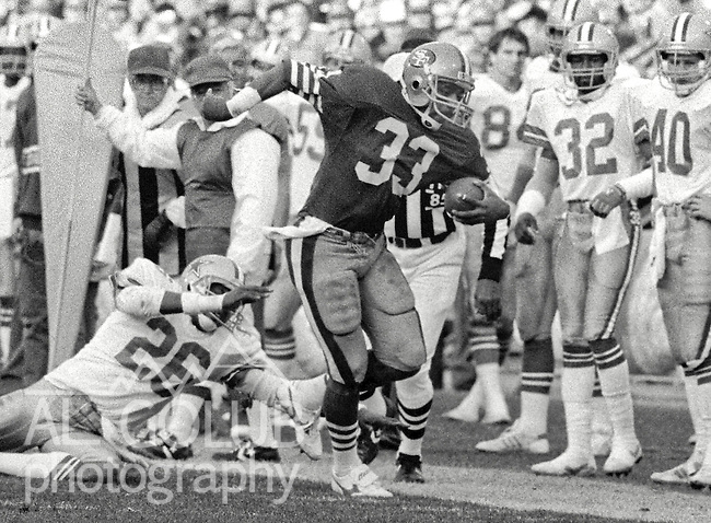 San Francisco 49ers vs. Dallas Cowboys at Candlestick Park Sunday, December 22, 1985..49ers beat the Cowboys 31-16.Dallas Cowboys Defensive Back Michael Downs (26) misses San Francisco 49ers Running Back Roger Craig (33)..
