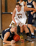SPEARFISH, SD - DECEMBER 15, 2013:  Katie Clements #5 of Colorado Mines tries to wrangle the ball while Logan Cowan #44 of Black Hills State hovers over her during their Rocky Mountain Athletic Conference game Sunday at the Donald E. Young Center in Spearfish, S.D.  (Photo by Dick Carlson/Inertia)