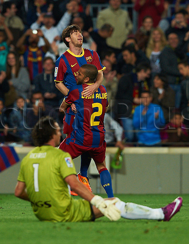 23.04.2011. Barcelona beat Osasuna 2-0 to remain on course for a third straight Spanish league title. Picture shows Lionel Messi and Dani Alves.