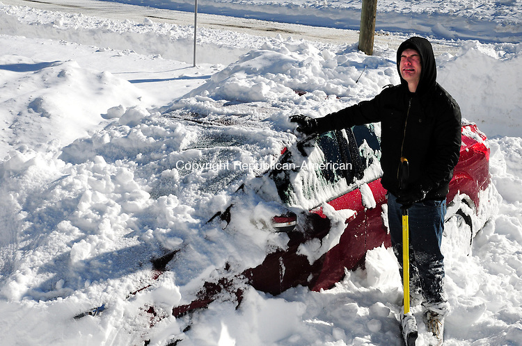 WINSTED CT, 09 FEB 13-020913AJ01-  Alex Senetcky jokingly reacts to his new car being buried by snow in Winsted Saturday.  Alec Johnson/ Republican-American