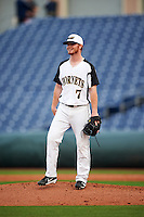 Alabama State Hornets relief pitcher Austin Bizzle (7) smiles after being hit with the ball after an infielder threw it in when Bizzle was not looking during a game against the Ball State Cardinals on February 18, 2017 at Spectrum Field in Clearwater, Florida.  Ball State defeated Alabama State 3-2.  (Mike Janes/Four Seam Images)