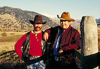Father and son standing together, wearing western clothing. Father and son portrait. Montana.