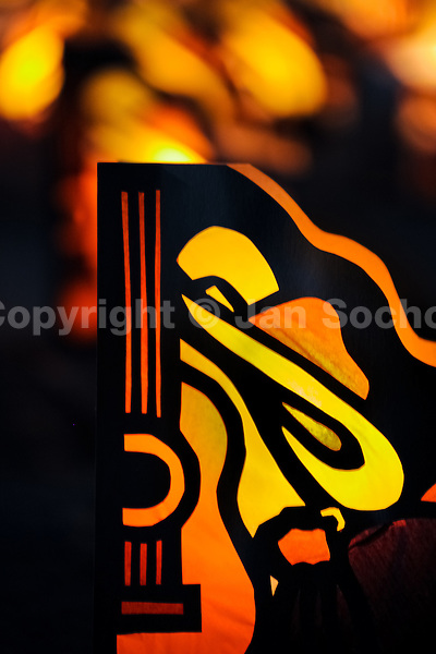 A colorful paper lantern, depicting a guitar, is seen shining on the street during the annual Festival of Candles and Lanterns in Quimbaya, Colombia, 8 December 2013. A vibrant event, celebrated since 1982 and attracting tens of thousands of visitors every year, is held in honor of the Virgin Mary, on the day of the Catholic Feast of the Immaculate Conception. Each street and neighborhood in the town compete in the contest to create the most spectacular lighting arrangement of their place, employing creatively elaborated lantern designs, which range from religious themes, to symbols of the coffee region or the environmental and wild nature motives. All the streets in Quimbaya center close for one night and some 40,000 lanterns are being lightened up at the festive night.