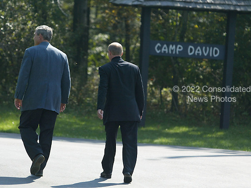 United States President George W. Bush, left, and President Vladimir Putin of Russia walk away together after a news conference September 27, 2003 at Camp David, Maryland. Putin arrived September 26 after attending official meetings at the United Nations in New York.  .Credit: Mark Wilson - Pool via CNP..