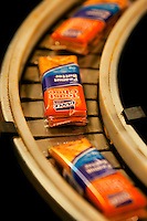 "Charlotte, NC-based Lance Inc., is one of the largest snack food manufacturers and distributors in the United States. The publicly traded manufacturing company makes snack crackers, sometimes referred to as ""Nabs."" Photo shows the brightly colored orange ToastChee Crackers (peanut-butter-filled cheese crackers) moving through the manufacturing process. Lance Inc., products include sandwich crackers and cookies, potato chips, crackers, cookies, sugar wafers, nuts, restaurant-style crackers and candy."