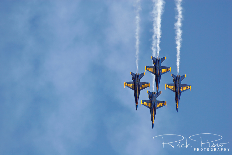 The Blue Angels in diamond formation pass complete a loop maneuver during 2007 San Francisco Fleet Week activities. The U.S. Navy Blue Angel's fly the F/A-18 Hornet. Photographed 10/07