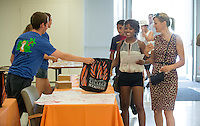 Incoming first-year Siyanna Ahmadu '18 checks in at Lower Herrick Chapel along with her mother, Susanne Siemonsen, during Occidental College Orientation, Aug. 22, 2014. (Photo by Marc Campos, Occidental College Photographer)