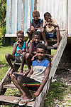 Peava Village, Gatokae Island, Solomon Islands; five boys sitting on the steps leading to their school house