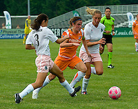 Sky Blue FC midfielder/forward Heather O'Reilly (9) splits between 2 Athletica players during a WPS match at Anheuser-Busch Soccer Park, in St. Louis, MO, June 7, 2009. Athletica won the match 1-0.
