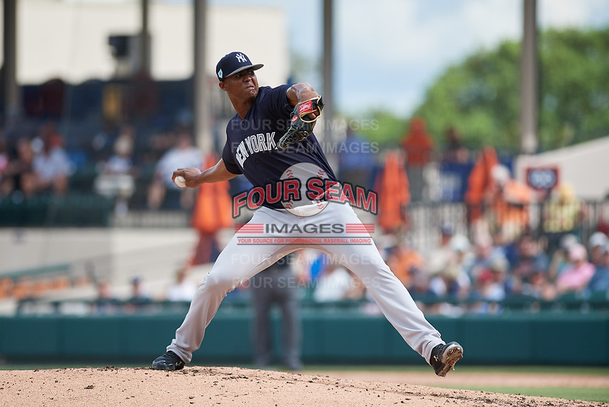 New York Yankees relief pitcher Domingo Acevedo (86) delivers a pitch during a Grapefruit League Spring Training game against the Detroit Tigers on February 27, 2019 at Publix Field at Joker Marchant Stadium in Lakeland, Florida.  Yankees defeated the Tigers 10-4 as the game was called after the sixth inning due to rain.  (Mike Janes/Four Seam Images)
