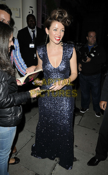 Dannii Minogue.at press preview of her Project D London s/s 2013 collection launch, No. 5 Cavendish Square, Cavendish Square, London, England..12th September 2012.full length funny blue dress sequins sequined fan signing autographs.CAP/CAN.©Can Nguyen/Capital Pictures.