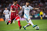 Karim Benzema (R) of Real Madrid battles for the ball with Niklas Sule of FC Bayern Munich during the UEFA Champions League Semi-final 2nd leg match between Real Madrid and Bayern Munich at the Estadio Santiago Bernabeu on May 01 2018 in Madrid, Spain. Photo by Diego Souto / Power Sport Images