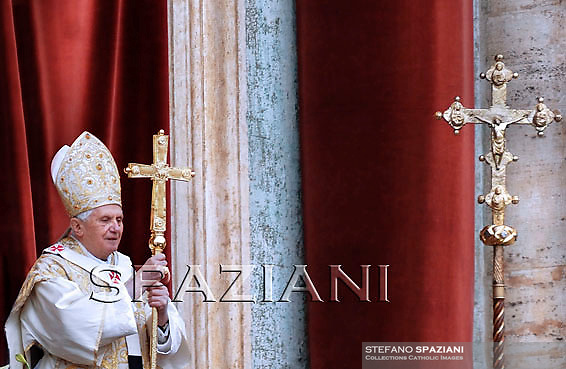 Pope Benedict XVI at the end of the message 'Urbi et Orbi from the central balcony of the Basilica of St. Peter in the Vatican today, April 4, 2010.