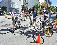NWA Democrat-Gazette/MICHAEL WOODS • @NWAMICHAELW<br /> Matt Brown, (from left) Gary Jech and Sharon Stafford, dismount from their bikes as they arrive at the Fayetteville square Saturday September 12, 2015 during the Square to Square bike ride event.  The bike ride went from the Bentonville square to the Fayetteville square covering 30 miles of the recently completed Razorback Regional Greenway.