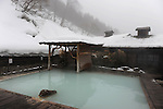Outdoor hot spring bath with snow at the Tsurunoyu Ryokan.<br />