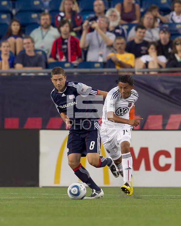 DC United midfielder Andy Najar (14) dribbles as New England Revolution midfielder Chris Tierney (8) defends. The New England Revolution defeated DC United, 1-0, at Gillette Stadium on August 7, 2010.