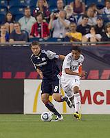 DC United midfielder Andy Najar (14) dribbles as New England Revolution midfielder Chris Tierney (8) defends. The New England Revolution defeated DC United, 1-0, at Gillette Stadium on August 7, 2010.