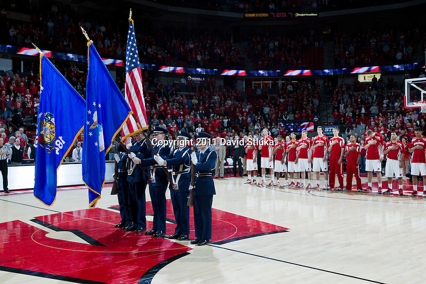 The color guard presents the flags during the National Anthem prior to the Wisconsin Badgers NCAA college basketball game against the Savannah State Tigers on December 15, 2011 in Madison, Wisconsin. The Badgers won 66-33. (Photo by David Stluka)