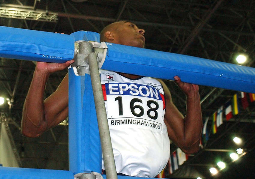 Photo. Javier Garcia.16/03/2003 World Indoor Athletics Championship, NIA, Birmingham.Colin Jackson hits the padded barrier for the last time and looks rueful after failing to make the medals