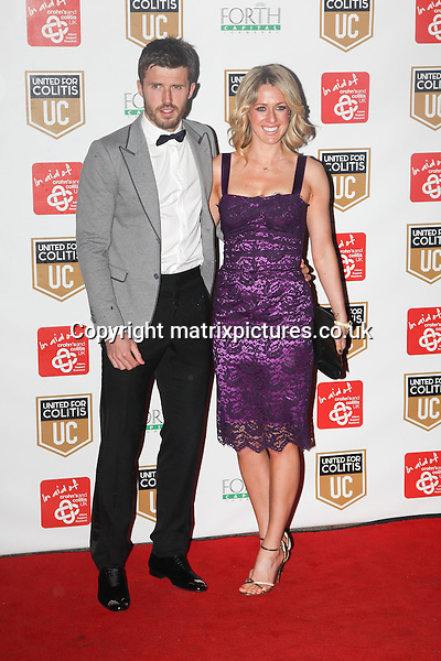 NON EXCLUSIVE PICTURE: MATRIXPICTURES.CO.UK<br /> PLEASE CREDIT ALL USES<br /> <br /> WORLD RIGHTS<br /> <br /> English professional footballer Michael Carrick, and wife Lisa, are pictured attending the United for Colitis charity dinner at the Old Trafford in Manchester, England.<br /> <br />  MARCH 27th 2014<br /> <br /> REF: MMY 141545