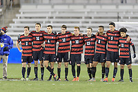 Houston, TX - Friday December 9, 2016: The Stanford Cardinal watch a teammate take his kick in the overtime shootout against the North Carolina Tar Heels at the NCAA Men's Soccer Semifinals at BBVA Compass Stadium in Houston Texas.