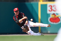 Rochester Red Wings shortstop Doug Bernier (17) throws to second from his knees after a diving stop for the force out during a game against the Norfolk Tides on May 3, 2015 at Frontier Field in Rochester, New York.  Rochester defeated Norfolk 7-3.  (Mike Janes/Four Seam Images)