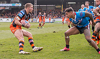 Picture by Allan McKenzie/SWpix.com - 11/03/2018 - Rugby League - Betfred Super League - Castleford Tigers v Salford Red Devils - the Mend A Hose Jungle, Castleford, England - Castleford's Glen Minikin attemptd to evade Salford's Greg Johnson.