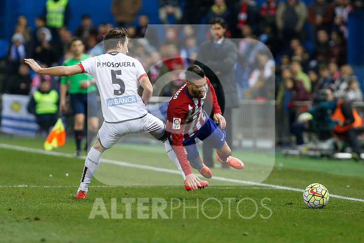 Atletico de Madrid´s Carrasco and Deportivo de la Coruna´s Mosquera during 2015-16 La Liga match between Atletico de Madrid and Deportivo de la Coruna at Vicente Calderon stadium in Madrid, Spain. March 12, 2016. (ALTERPHOTOS/Victor Blanco)