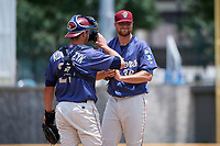 Frisco RoughRiders pitcher Blake Bass (36) talks with catcher Alex Kowalczyk (27) during a Texas League game against the Midland RockHounds on May 21, 2019 at Dr Pepper Ballpark in Frisco, Texas.  (Mike Augustin/Four Seam Images)