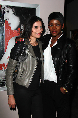 "BEVERLY HILLS, CA - FEBRUARY 28: Gabriella Wright, Caroline Chikezie at the ""Everly"" Opening Weekend Splatter-Ganza at Laemmle's Music Hall, Beverly Hills, California on February 28, 2015. Credit: David Edwards/DailyCeleb/MediaPunch"