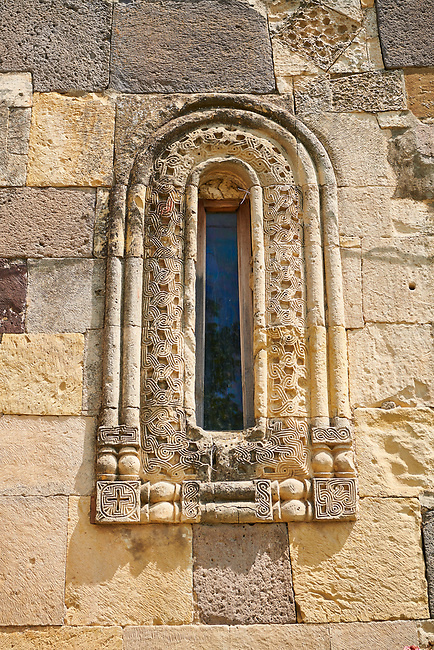 Picture & image of sculpted geometric Georgian style window surround stonework of the Cathedral Of Transfiguration, Medieval Georgian Orthodox, 7-9th century,  Ruisi, Georgia.<br /> <br /> A typical Georgian cruciform & cupola church Ruisi Cathedral Of Transfiguration was built by King Vakhtang Gorgasali in a typical 7th century style.