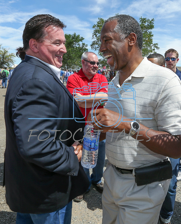 Nevada GOP Chairman Michael McDonald, left, greets Republican presidential candidate Dr. Ben Carson at the Inaugural Basque Fry in Gardnerville, Nev., on Saturday, Aug. 15, 2015. <br /> Photo by Cathleen Allison