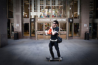 A man on a skateboard rides in front of a the Standard Life Centre in Toronto financial district April 19, 2010.  Formerly a mutual society, Standard Life plc (LSE: SL.) is a financial services institution based in Edinburgh, Scotland.