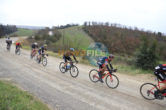 Group two including Greg Van Avermaet (BEL) BMC and Michal Kwaitkowski (POL) Team Sky on gravel sector 6 Pieve a Salti during the 2017 Strade Bianche running 175km from Siena to Siena, Tuscany, Italy 4th March 2017.<br /> Picture: Eoin Clarke | Newsfile<br /> <br /> <br /> All photos usage must carry mandatory copyright credit (&copy; Newsfile | Eoin Clarke)