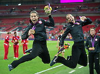 London, England - Thursday, August 9, 2012: The USA defeated Japan 2-1 to win the London 2012 Olympic gold medal at Wembley Stadium. Kelley O'Hara and Heather Mitts jump for joy with their gold medals. .