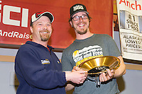 Aaron Burmeister, Official Finisher's Club president<br /> presents Brent Sass with the First Musher to Ophir Award at the musher finisher's banquet in Nome during the 2016 Iditarod.  Alaska    <br /> <br /> Photo by Jeff Schultz (C) 2016  ALL RIGHTS RESERVED