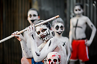 Salvadoran boys, having white body paint with death symbols, perform during the La Calabiuza parade at the Day of the Dead festivity in Tonacatepeque, El Salvador, 1 November 2016. The festival, known as La Calabiuza since the 90s of the last century, joins Salvador's pre-Hispanic heritage and the mythological figures (La Sihuanaba, El Cipitío, La Llorona etc.) collected from the whole Central American region, together with the catholic All Saints Day holiday and its tradition of honoring the dead relatives. Children and youths only, dressed up in scary costumes and carrying painted carts, march from the local cemetery to the downtown plaza where the party culminates with music, dance, drinking and eating pumpkin (Ayote) with honey.