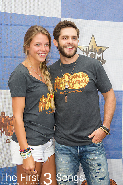 Thomas Rhett and Lauren Akins attends the Cracker Barrel Old Country Store Country Checkers Challenge at Globe Life Park in Arlington on April 18, 2015 in Arlington, Texas