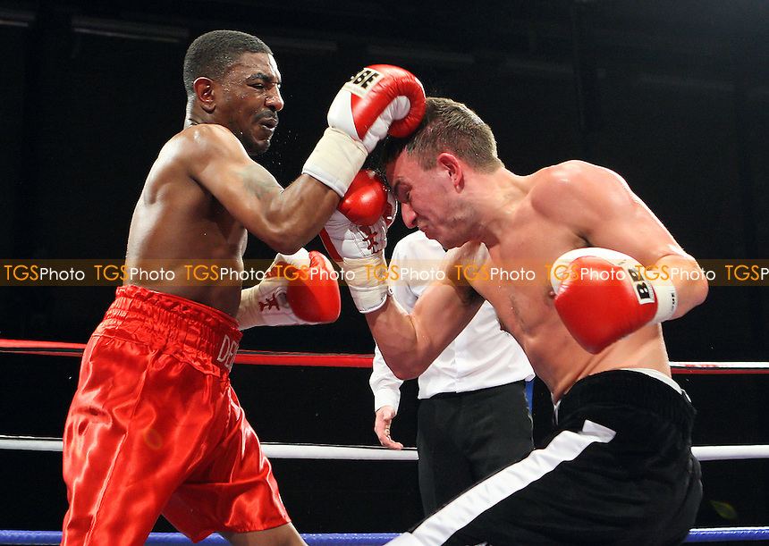 Lewis Pettitt (black shorts) defeats Delroy Spencer in a Featherweight boxing contest at Goresbrook Leisure Centre, Dagenham, promoted by Frank Maloney - 14/05/10 - MANDATORY CREDIT: Gavin Ellis/TGSPHOTO - Self billing applies where appropriate - Tel: 0845 094 6026