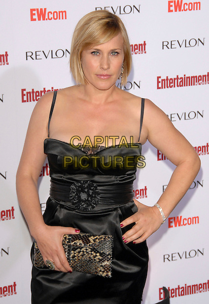 PATRICIA ARQUETTE.attends The Entertainment Weekly 5th Annual Pre-Emmy Party held at Opera & Crimson in Hollywood, California, USA, September 15th 2007.                                                                                       half length black dress hand on hip clutch bag.CAP/DVS.©Debbie VanStory/Capital Pictures
