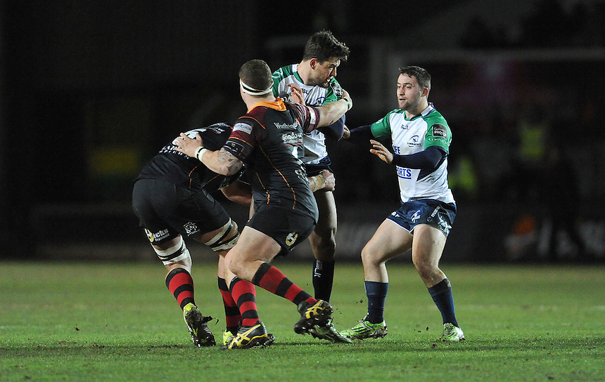 Connacht's Tiernan O'Halloran is tackled by Newport Gwent Dragons' Ben White<br /> <br /> Photographer Ian Cook/CameraSport<br /> <br /> Rugby Union - Guinness PRO12 Round 14 - Newport Gwent Dragons v Connacht - Thursday 11th February 2016 - Rodney Parade - Newport<br /> <br /> &copy; CameraSport - 43 Linden Ave. Countesthorpe. Leicester. England. LE8 5PG - Tel: +44 (0) 116 277 4147 - admin@camerasport.com - www.camerasport.com