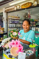 Thailand, Koh Samui Island. Woman selling coconut ice cream.