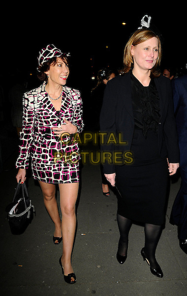 "KATHY LETTE & SARAH BROWN .""Hats: An Anthology by Stephen Jones"" Private View, V & A Museum, London, England, February 23rd 2009..Victoria and Albert full length black and pink white print suit skirt matching jacket black  hat .CAP/CAN.©Can Nguyen/Capital Pictures"