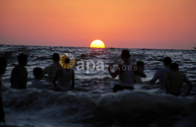 Palestinians enjoy swimming in the sea at Gaza beach during Friday holiday in Gaza city, Aug 24, 2012. Gazans escape to the beach and out from their homes during heat wave and power outages. Photo by Ashraf Amra