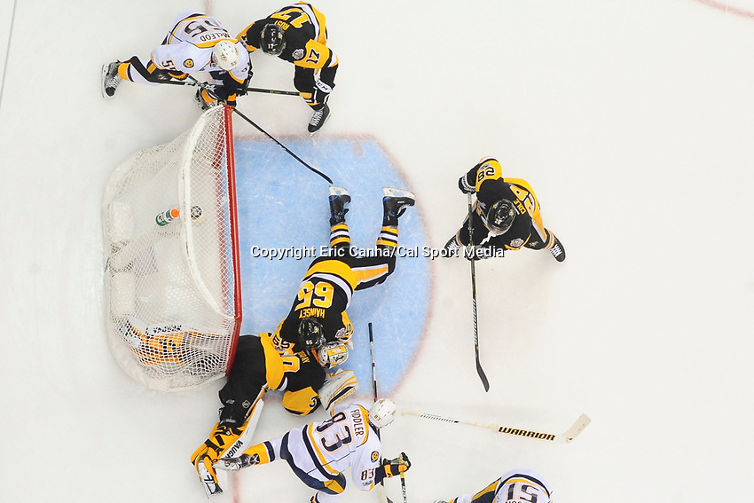 May 29, 2017: Pittsburgh Penguins goalie Matt Murray (30) straddles the pipe while making a save during game one of the National Hockey League Stanley Cup Finals between the Nashville Predators  and the Pittsburgh Penguins, held at PPG Paints Arena, in Pittsburgh, PA. Pittsburgh defeats Nashville 5-3 in regulation time.  Eric Canha/CSM
