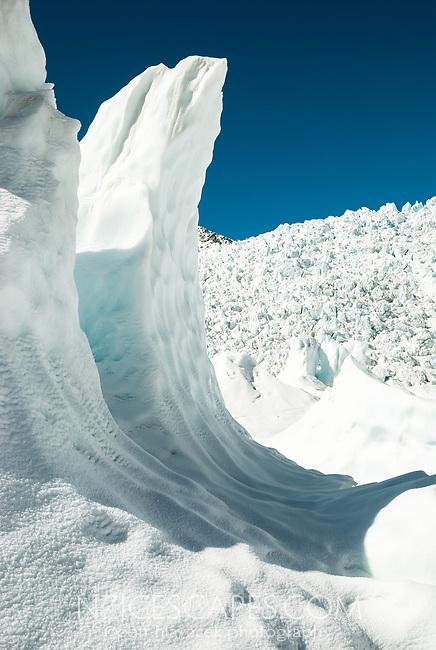 Walking under massive ice waves on Franz Josef Glacier. Main Icefall in background, Westland Tai Poutini National Park, UNESCO World Heritage Area, West Coast, New Zealand, NZ